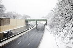 Plowed highway on a winter day Royalty Free Stock Image