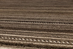 Plowed land. close-up. An agricultural field which has been plowed for planting crops. Spring. close-up Royalty Free Stock Image