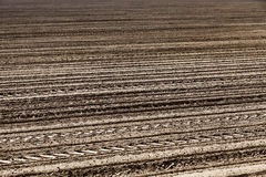 Plowed land. close-up. An agricultural field which has been plowed for planting crops. Spring. close-up Royalty Free Stock Photography