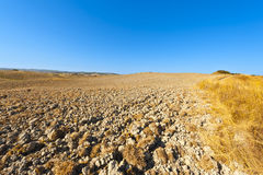 Plowed land in Italy. Plowed hills of Tuscany in the autumn. Plowed agricultural land in Italy Royalty Free Stock Photo