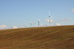 Plowed land and wind turbine in the Champagne Royalty Free Stock Photography