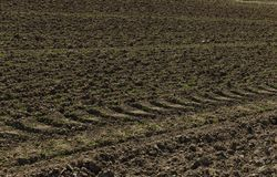 Plowed soil on agricultural fields in spring. Soil texture background Royalty Free Stock Photos