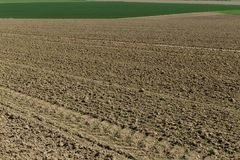 Plowed soil on agricultural fields in spring. Soil texture background Royalty Free Stock Photo
