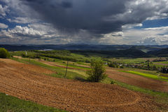 Plowed soil and rain in background Royalty Free Stock Images