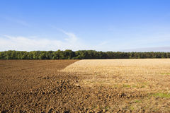 Plowed soil and straw stubble Stock Photos