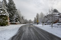 Plowed Street in North America Suburban Neighborhood. Plowed Salted de-iced street in North American suburban neighborhood Happy Valley Oregon stock photography
