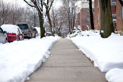 Plowed walkway after a snowstorm Stock Image