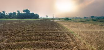 Plowed in winter field arable land. Clay soils of southern India, small farm operator Stock Photos