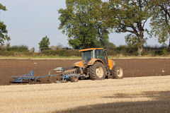 Plowing autumn stubble Royalty Free Stock Image