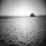 Plowing the beach. Artistic look in black and white. Stock Photos