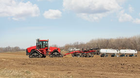 Plowing and Fertilizing Royalty Free Stock Images
