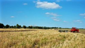 Plowing field with Pochayiv Lavra on background stock video