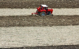 Plowing fields with a tractor Stock Photo