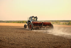 Plowing the land. Agricultural work. Stock Photos