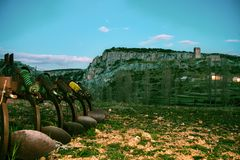 Plowing machine in a landscape Royalty Free Stock Image