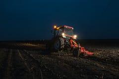 Plowing at night Stock Photos