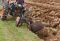 Plowing with an old plow Stock Photos