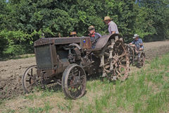 Plowing with old tractor Royalty Free Stock Image