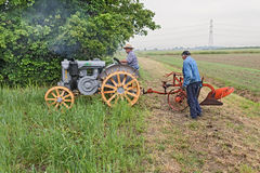 Plowing with an old tractor Royalty Free Stock Photography