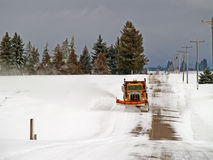 Plowing the Rural Road Royalty Free Stock Photo