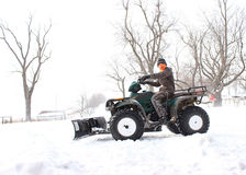 Plowing Snow. There is nothing more fun to a young boy on a farm in the winter than getting to plow the driveway stock photos