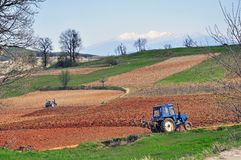 Plowing tractor Royalty Free Stock Images