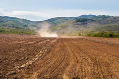 Plowing Tractor on Agricultural Field Stock Photography