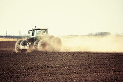 Plowing with tractor Royalty Free Stock Images