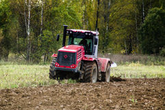 Plowing tractor. Stock Photo
