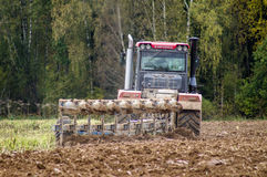 Plowing tractor. Royalty Free Stock Photos