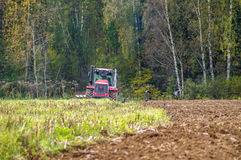 Plowing tractor. Stock Photos