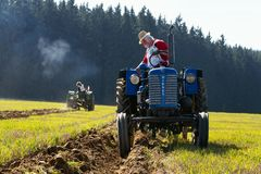 Plowing vintage veteran tractors on field on ploughing championship stock images