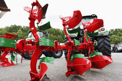 Plowsm and farming tractors Stock Photos