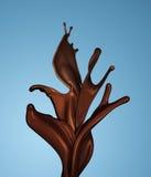 Pluśnięcie brudno- gorąca kawa lub czekolada odizolowywający obrazy royalty free