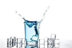 pluśnięcie szklana woda Fotografia Stock