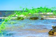 Pluśnięcie zielony ciecz Obrazy Stock
