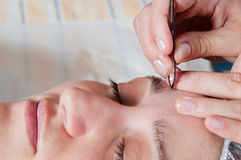 Pluck eyebrows Royalty Free Stock Photo