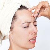 Pluck eyebrows Royalty Free Stock Photography