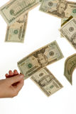 Plucking cash. Hand plucks cash out of thin air as it falls on white background Royalty Free Stock Photos