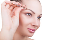Plucking eyebrows Royalty Free Stock Photography