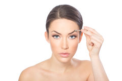 Plucking eyebrows Stock Photo