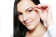 Plucking tweezers brow Royalty Free Stock Photography