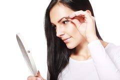 Plucking tweezers brow Stock Images