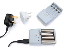 Plug adapter, charger and battery. Royalty Free Stock Images
