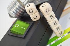 Plug bar with a tree in a light bulb and cubes go green. Plug bar with light bulb and cubes go green stock images