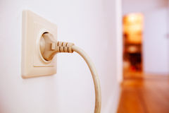 Plug connected to wall Stock Photography