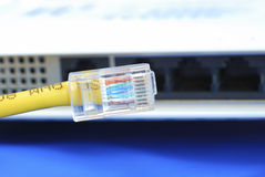 Plug the Ethernet cable to the router or bridge Royalty Free Stock Photography