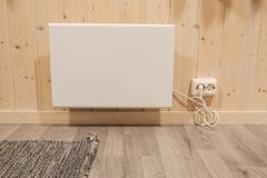 Plug-in heater at house wall in winter stock photography
