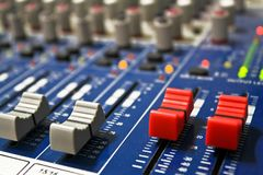 Plug a microphone and volume control knob on the panel Royalty Free Stock Photos