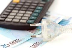 Plug and money Stock Photo